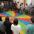 PLoP 2018 -- Traditional closing ceremony @PLoPCon, tossing ball of yarn to connect to other attendees remembered in the meeting.  After the threads have fully unravelled, the web is tossed in the parachute.  (Pattern Languages of Programs conference, University of Oregon, NW Couch Street, Portland, Oregon) 20181026