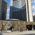 Toronto City Hall -- Pre-dusk @nuitblancheTO, @ibrahim_mahama drapes jute sacks over the roof edges of building facing @npstoronto, drawing attention to complex trade networks of a global economy and invisible labour.  I've previously seen Coal Sacks by this artist @saatchi_gallery in London, so both the materials and the observers move.  (Toronto City Hall, Nathan Phillips Square, Queen Street, Toronto, Ontario) 20180929