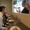 Richmond Station -- Attentive server describing each dish as it's placed before us, as we're surprised.  A list of allergies was sent in advance, and then preferences were discussed with each of the dinner guests.  She said they enjoy the challenge of creativity.  In the background the pastry chef was also managing the oven, warming up those sitting towards the west side of the 3-hour family celebration of RDI's 25th birthday.  (Richmond Station, Richmond Street West, Toronto, Ontario) 20180910