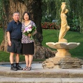 Edward Gardens -- The 33rd time we've reconvened at the fountain to renew our marital commitment.  CL was thoughtful in giving us flowers to celebrate the occasion.  This year, the weather was cool and the fountain was drained.  (Edward Gardens, Lawrence Avenue East, Don Mills, Ontario) 20180824