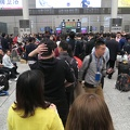 Hongqiao Railway Station -- Long queue builds anxiety, as gates open just 20 minutes before train leaves, and platform is through the turnstiles and down stairs. Chinese crowds are pushy, in contrast to more orderly western groups. D-train Shanghai-Wuhan speed is up to 250km/h, as compared to G-train up to 300km/h. (Hongqiao Railway Station, Shanghai, PR China) 20180418