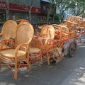 Fushun Road -- Wicker chairs on cart pulled by worker on foot on the city street, in the old fashioned way.  Had a morning walk around the neighbourhood south of Tongji U., active with early shoppers at markets.  (Fushun Road, Siping district, Shanghai, PR China) 20180417
