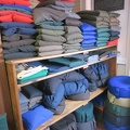 Snow Lion Meditation Shop -- Selected buckwheat hull pillow to replace one that predates my current spouse.  This shop offers smaller ones to be used as meditation cushions, we chose the largest for our bed.  We may continue to look for just hulls, 5 lbs. should fill the old pillowcase.  (Snow Lion Mediation Shop, Pape Avenue, Toronto, Ontario) 20180328