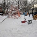 Degrassi Street Park -- Playground spacenet not an attraction when there's winter snow everywhere.  Observed children down the street playing on their front lawns, as parent cleared walks.  Unusual walk for me from home to Chinatown East for groceries, too wet for bicycling, shopping list too small to justify driving.  (Degrassi Street Park, South Riverdale, Toronto, Ontario). 20171223