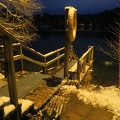 Ahvenisto Lake -- Winter swimming area kept clear of ice by air bubbling near shore.  Steps down from public sauna are kept warm for health enthusiasts who want to warm up before plunging into the cold.  In early evening, saw visitors headed towards the building, then a woman emerged in near freezing temperatures to enter the water.  We walked a path around the lake, illuminated after the sunset before 3:30 p.m.  (Ahvenisto Lake, Hameenlinna, Finland) 20171202