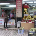 Guoquan Zhengben Market -- Morning dumpling vendor on edge of local market offering fruit, vegetables and meat. Pastry was in crescent and cylinder shape, my breakfast sampling says the filling is the same for both.  Ate takeout in the Sino-Finnish Centre kitchen, juices sprayed out onto table, I cleaned up afterwards.  (Guoquan Road Market at Zhengben Road, WuJiaoChang, Shanghai, PR China) 20171122