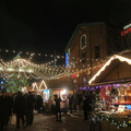 Distillery District -- Crowds @TOXmasMkt Wednesday night 8:30pm @DistilleryTO.  Lineups at poutine shack, couples taking selfies.  Many young adults, a few children at attractions.  Not shopping, just cycling through.  (Distillery District, Mill Street, Toronto, Ontario) 20181212