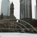 Nathan Phillips Square -- Rink is cleared of skaters for 13 minutes, open for midday resurfacing with the Zamboni.  Obedient crowds left the ice within a minute of guards blowing whistles and an announcement over the loudspeaker.  Expect an even larger mob approaching midnight, as entertainers on the stage counts down to the new year.  (Nathan Phillips Square, Queen Street West, Toronto, Ontario) 20181231