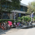 Design Square -- Last year's overabundance of dockless bicycles has been curtailed, so sidewalks are more easily passable.  The university is replacing the plants outside the entry with new ones, rather than cultivating survivors from winter.  Morning rain left the air clean, spring temperatures are definitely welcomed.  (Design Square, Tongji University, Siping Road, Yangpu district, Shanghai, PR China) 20190320