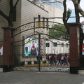 Xiangming Junior High School -- Blaring rock music and bright large screen video at 7:55 a.m., with students running around in circles behind the entry gate with a guard attending.  Julu Road is otherwise a quiet two-lane residential street, so the commotion is a daily event somewhat more mundane than changing of the guard.  Morning walk was for an early taxi pickup, anticipating a full date with students at the university.  (Xiangming Junior High School, Julu Road, Shanghai, PR China) 20190321