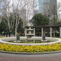 Xiangyang Park -- Still too early for cherry blossoms, this fountain is the north end of the park with a French-style boulevard.  Opened by the Conseil Municipal of the French Concession in 1942, it was named Lan Weina Park or Dumet Park in 1939, then Taishan Park in 1943 and Linsen Park in 1945, before taking the current name in 1950. Some badminton players put up a net a little further south.  (Xiangyang Park, Huaihai Middle Road, Shanghai, PR China) 20190325