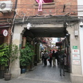 Tianzifang -- Shikumen (stone warehouse gate) transformed into a warren of alleys with shops, food stalls and restaurants.  Complex still has residents, at least one with the sense of humour for a pink panther in the window.  Not in a shopping mood, the lanes were walkable on the afternoon before the weekend begins.  (Tianzifan, Taikang Lu, Shanghai, PR China) 20190329