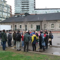 "Janes Walk, Distillery Lane -- On land @JanesWalkTO led by @JohnLorinc ""A Meandering History of the Lower Don"" that was Ashbridges Bay Marsh before landfill.  Cherry Street would have been part of the Don River delta, before the waterway was channelled further east, with an unnatural 90-degree turn as the Keating Channel in the late 1890s.  The combination of industrial waste and human excrement combined into public health hazard, corrected with conversion into a massive industrial district from 1912-1922.  Today, the Gooderham and Worts site has been redeveloped into the Distillery District.  (Distillery Lane, Distillery District, Toronto, Ontario) 20190504"