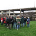 "Janes Walk, Villiers Street at Don Roadway -- Wet grass @JanesWalkTO led by @JohnLorinc ""A Meandering History of the Lower Don"" on land that will become a new shallower southbound channel emptying into wetland.  Keating Channel will remain as the deeper westbound channel, with new promenades at water's edge, while the Gardiner Expressway is moved further north. The Don River was never straight lines, these engineering projects aim to renaturalize the landscape to preempt flooding.  (Distillery Lane, Distillery District, Toronto, Ontario) 20190504"