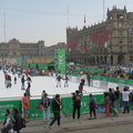 Zocalo -- Higher vantage point of skating rink on Plaza de la Constitucion, from @Turibuscdmx upper deck.  Federal District building decked out for Christmas one week away.  We started Circuito Centro Historico from Reforma 222 to Auditorio, and then changed to the Circuito Chapultepec Polanco.  Sitting upstairs with temperature dropped after sunset, city traffic at a crawl, we abandoned the loop at the Museo Del Nino, and hoped an Uber ride would be more direct.  (Zocalo, Plaza de la Constitucion, Mexico City) 20191218