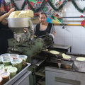 Tortilleria Cuauhtemoc -- Masa dough feeding into a press at small stall of #TortilleriaCuauhtemoc in back of our local #MercadoCuauhtemoc for fresh flatbread packaged to go, with salsas and guacamole on the side.  From our apartment, we walk a few blocks for fresh fruit and vegetables, as well as sampling the centre aisle of open kitchens.  The neighbourhood otherwise has convenience stores, but we haven't encountered any major chains, since we arrived.  (Tortilleria Cuauhtemoc, Mercado Cuauhtemoc, Calle Rio Lerma, Mexico City) 20191219