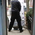 Riverside neighbourhood -- Professional delivery of a new refrigerator, and old one hauled away, at home.  Deliveryman had tape measure to check entry, asked for a hammer, and then removed door to accommodate width.  We had cleared hallway, EKI and I took a few extra moments to finishing emptying contents, mostly onto our back deck in a Canadian winter day before freezing.  Evokes memories of myself doing refrigerator deliveries for Kent Tv in Gravenhurst, in the 1970s.  (Riverside neighbourhood, Toronto, Ontario) 20200219