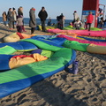 Woodbine Beach -- Art installation of recycled sailcloth stuffed with straw #NoodleFeed @iheartblob attracts children @winterstations on a clear, bright day above the freezing point.  Some took off their boots, others jumped with them on.  First bicycling day in a while, wind felt heavy travelling east and then back west.  (Woodbine Beach, Toronto, Ontario) 20200223