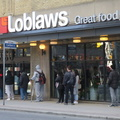 Loblaws 60 Carlton -- Appreciating orderly social distancing by Torontonians @LoblawsCarlton lined up around the block, on a clear Saturday late afternoon with temperature hovering around freezing.  No shopping for me, just bicycling for fresh air and exercise along relatively quiet city streets.  Our citizens aren't totally locked down, we trust each other to maturely use our own judgement.  (Loblaws, 60 Carlton Street, Toronto, Ontario) 20200321