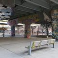 Underpass Park -- Public space unoccupied, with yellow tape not only on playground equipment, but also benches, to discourage social gatherings.  Citizens mostly respecting physical distancing directions to stay at home.  Dogs out walking their masters, who may get more exercise than others who aren't leaving the house.  (Underpass Park, Lower River Street, Toronto, Ontario) 20190419