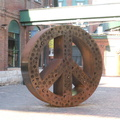 Distillery District -- Unadorned and unilluminated as in @tolightfest, the #SymbolicPeace scupture by #StudioRosenblatt was first installed in early 2019. Laser cut, cold rolled steel celebrating diversity in the community stands silent on a bright afternoon where a normally teeming plaza is now deserted.  Art galleries are closed, so more permanent outdoor sites have to be sought.  (Gristmill Lane, Distillery District, Toronto, Ontario) 20200422