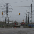 Don Roadway -- Roadblock southbound into the Portlands now blocked to vehicular traffic, with ongoing construction.  Don Roadway is being rebuilt to a higher elevation, so that major rainfalls flooding the Keating Channel won't spill over into the lands on the east side of the road.  It's a dull afternoon for bicycling.  (Don Roadway, Portlands, Toronto, Ontario) 20200430