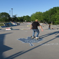 Ashbridges Bay Skateboard Park -- One of 14 skateboard parks open in Toronto, with city is still in Phase 1 reopening while most of province is in Phase 2.  Clear, bright afternoon, although temperatures barely warm enough to wear shorts.  On bike path, parents guiding children on small bicycles, while racers in spandex zoom by.  (Ashbridges Bay Skateboard Park, Lake Shore Boulevard East, Toronto, Ontario) 20200616