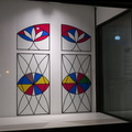 Fentster -- Storefront gallery @MakomTO installation @RDavidovitz (2020) What Will Remain stained glass sculpture has cracked panes, when inspected more closely.  Toronto-based artist pays tribute to grandfather who would repair broken windows in post-war Vilna (then Poland, now Lithuania). On the eve of statutory holiday, few people on the street, except for pizza pickups next door.  (Fentster /  Makom: Creative Downtown Judaism, College Street West, Toronto, Ontario) 20200630