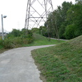 Warden Woods Hydro Corridor -- Footpath between Pidgeon Street and Chestnut Crescent connects two residential neighbourhoods with townhouses backing onto the hydro towers.  West side is new townhouses, east side is more established detached houses.  Found cycling route as a detail on map, to avoid street descending into St. Clair Ravine and then having to climb out again.  (Warden Woods Hydro Corridor, Pidgeon Street to Chestnut Crescent, Scarborough, Ontario) 20200905