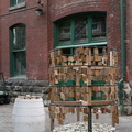Artscape Distillery Studios -- On Case Goods Lane, #distillerywisdom installation invites visitors to write memories on wooden plaques to be hung, or on small stones placed at the base of a cylindrical frame.  Messages left by participants from many parts of the world, and in many languages.  Art that changes daily, and is durable in weather fair and fowl.  (Art Distillery Studios, Case Goods Lane, Distillery District, toronto, Ontario) 20200911