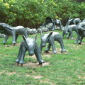 Metro Hall -- About half of the 17 bronze rabbit-dog sculptures #CynthiaShort 1992 Remembered Sustenance, originally installed expecting that children might play with them.  Small grass parkette is popular with dogs and walkers, who seem to ignore the figures.  Just south of the theatre district, where the stages are dark.  (Metro Hall, Wellington Street West, Toronto, Ontario) 20200915