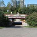 Bala Rail Underpass -- In the mouth-of-the-Don district, a passage fot pedestrians and bicyclists from the Lower Don River Trail westbound towards Corktown Commons.  On The Canadian passenger train from Union Station 4 days to Vancouver, the next step is Washago, and then Parry Sound.  Constructed in 2007, the interior murals painted for the PanAm games in 2015 have faded, with external clearance hazards now more prominent.  (Bala Rail Underpass, Lower Don River Trail, Toronto, Ontario) 20200921