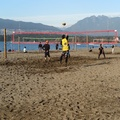 Kitsilano Beach -- Volleyball courts full on a sunny day, next to English Bay, with the mountains of the north shore as background.  Leisurely stroll west to Elsje Point, and then west to Point Grey Park.  Bright days like this leads visitors to forget the grey days from November through March.  (Kitsilano Beach, Vancouver, BC) 20201031