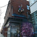 Ossington Laneway -- Rattlesnake sculpture mounted on second-floor alley wall for @thestrumbellas 2019 album release endures.  Installation was an unexpected sight while pedalling along Queen Street West, leading to explore a route northbound.  Path led to a series of murals on garage doors seeing weather, dropping temperature may see snow within weeks.  (Ossington Laneway, Queen Street West, Toronto, Ontario) 2020114