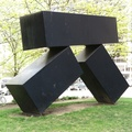 R. Fraser Elliott Building -- Kosso Eloul (1978) Innercity Gate sculpture welds three black stainless steel rectangular boxes in a precarious balance.  Straight lines show influences of artist's studies with Frank Lloyd Wright.  Outside a wing of Toronto General Hospital, not on a medical visit, just bicycle tourism.  (R. Fraser Elliott Building, Elizabeth Street, Toronto, Ontario) 20210425