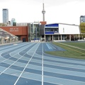 Varsity Stadium -- Blue and white are the colours for UToronto, so the track is thus themed.  Summer session officially starts in 2 days, although the pandemic stay-at-home order precludes organized athletics, even outside.  View south catches the CN Tower, a landmark years before the field was constructed.  (Varsity Stadium, Bloor Street West, University of Toronto) 20210501