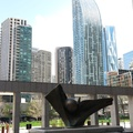 Leader Lane -- Looking south, in courtyard #AndrewPosa (1982) U. V. Ceti sculpture in honour of architect #EdwardIsaacRichmond.  In the distance, the L Tower designed by #DanielLibeskind is shaped with a backward curve so that the 58-floor residential condominiums don't block the light onto #BerczyPark.  Biking down to the building, it's the repurposing of the southern wing of #MeridianHall, formerly known as #SonyCentre, #HummingbirdCentre and #OKeefeCentre.  (Leader Lane, 30 Wellington Street West, St. Lawrence district, Toronto, Ontario) 20210508