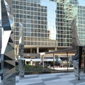 Meridian Hall Plaza -- View north from triptych @HarveyValentine (2016) Dream Ballet stainless steel sculptures, against a background of reflections with buildings in mirrored windows across Front Street at 33 Yonge Street.  Grey tiles confuse the shapes in the chrome with strange angels.  Plaza is a natural open space for children from the L Tower to the south.  (Meridian Hall, Yonge Street at Front Street East, Toronto, Ontario) 20210512